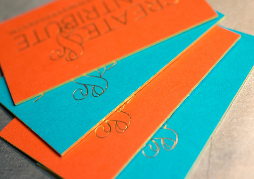 Detail of the card backs with gold painted edges.