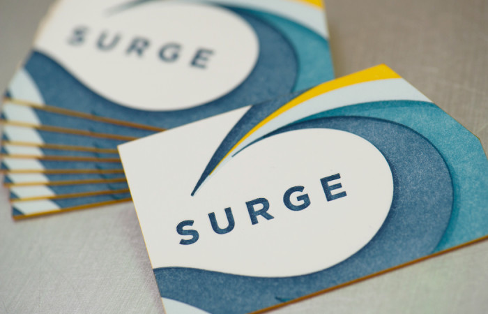 Surge die cut business cards, design by Culture Pilot, letterpress printing by Workhorse Printmakers, Houston, Texas